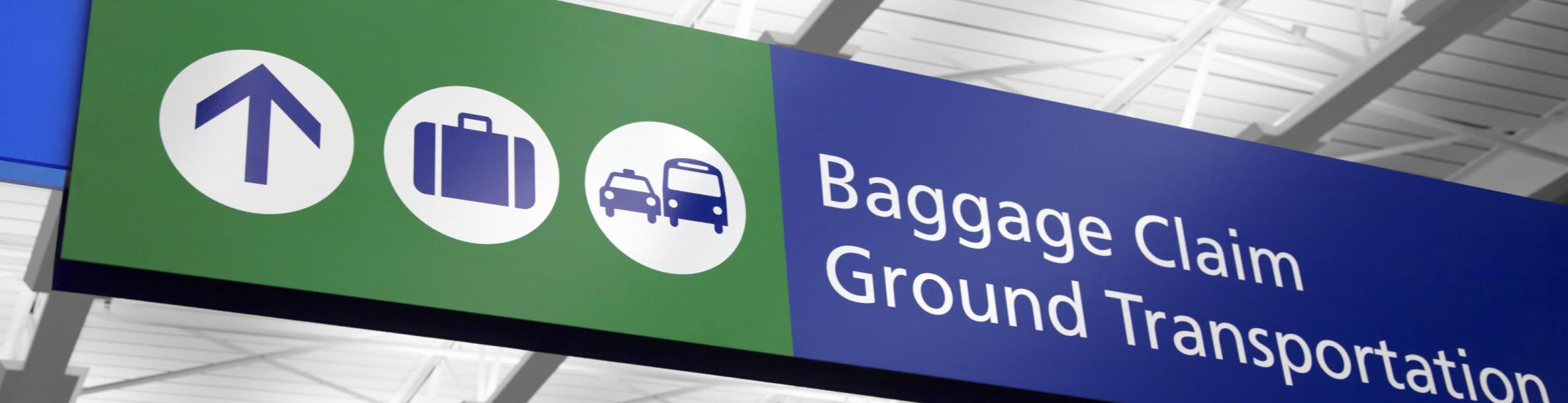 "Airport sign that says ""baggage claim"" and ""ground transportation"""