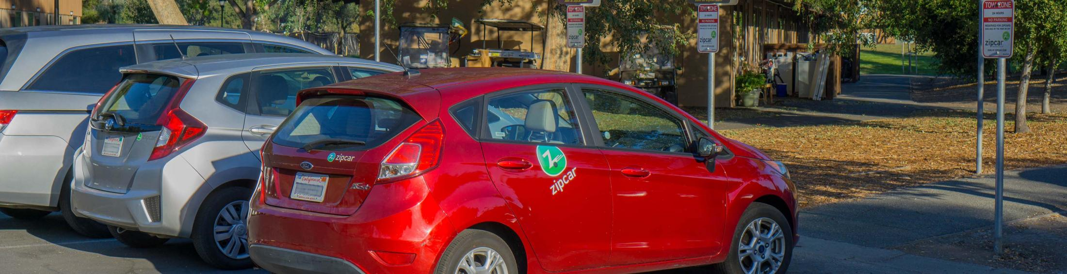 Zipcar vehicles parked in front of designated spots