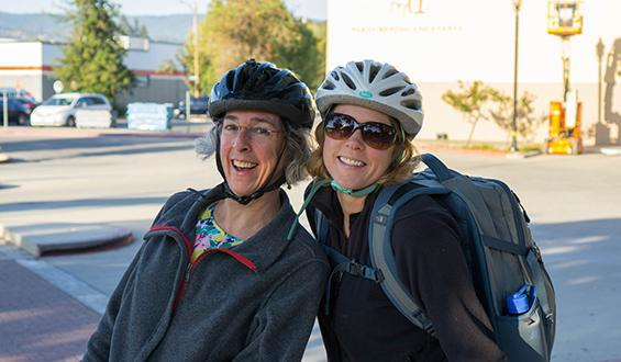 two bicyclists smiling