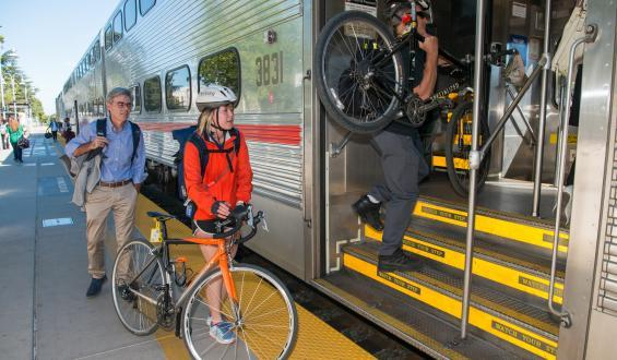 cyclists loading bikes on Caltrain