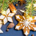 winter holiday background with cookies, lights, and pine needles